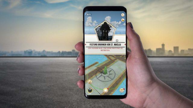 Am Smartphone eine Festung in Harry Potter: Wizards Unite suchen.
