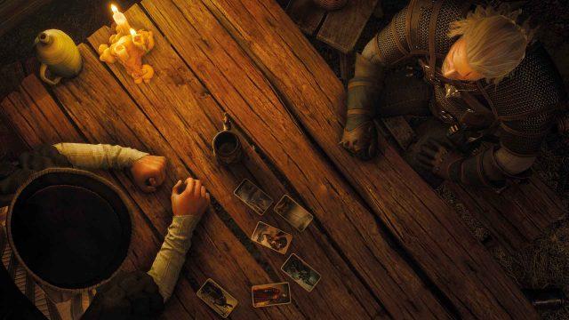 The Witcher - Geralt sitzt am Tisch mit einer anderen Figur und trifft eine Entscheidung