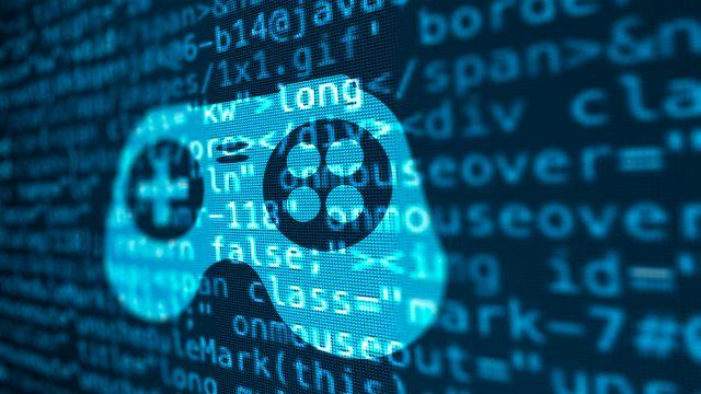 Auf einem Bildschirm ist ein Programmiercode zu sehen, daraus das Symbol eines Konsolen-Controllers eingeblendet.