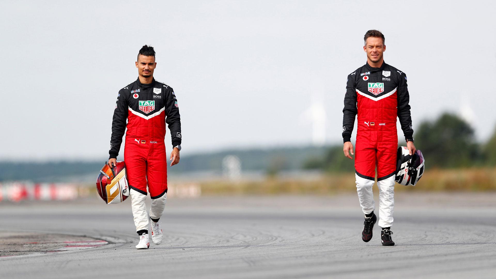Pascal Wehrlein und André Lotterer laufen über die Rennstrecke