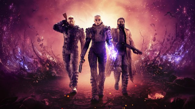 """Eine bewaffnete Frau und zwei Männer aus dem Spiel """"Outriders"""" nähern sich in Science-Fiction-Outfits."""