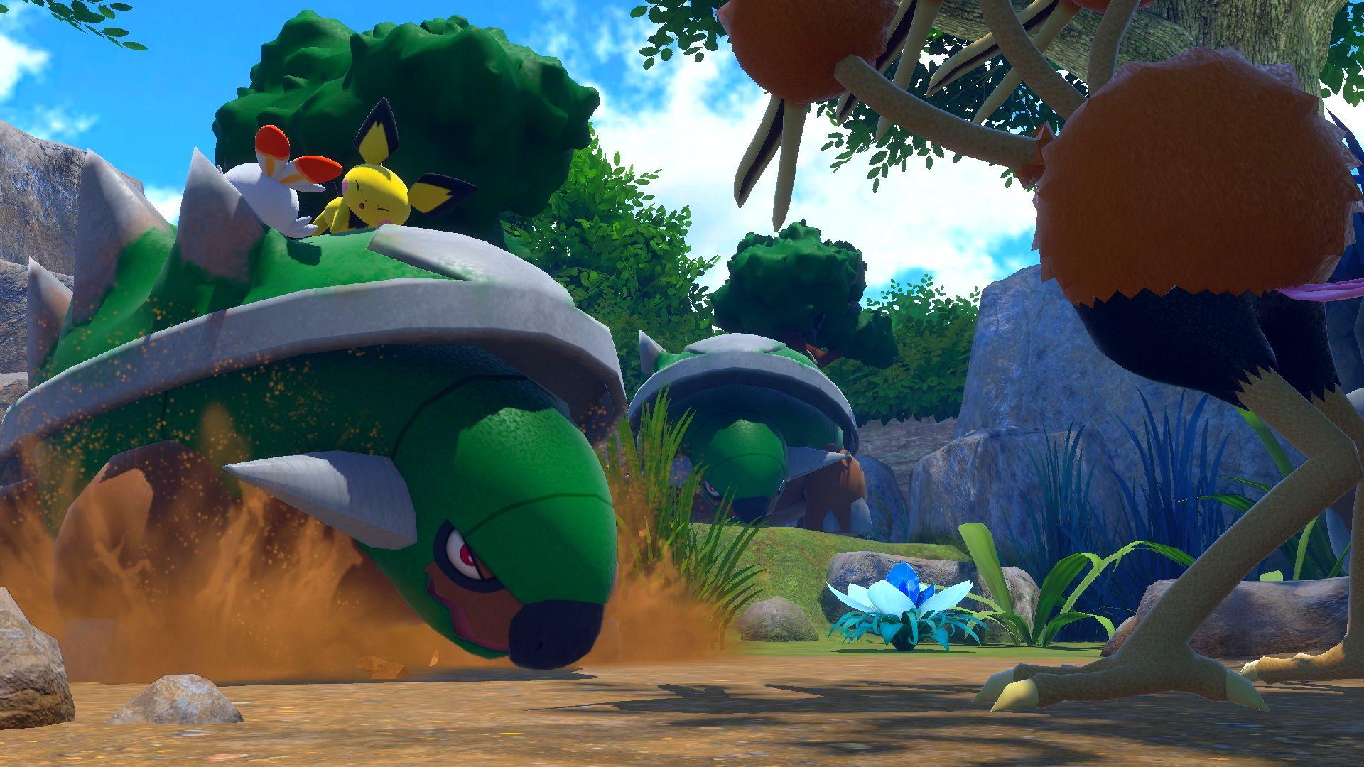 """Mehrere Pokémon stehen sich in einem Wald im Spiel """"New Pokémon Snap"""" gegenüber."""
