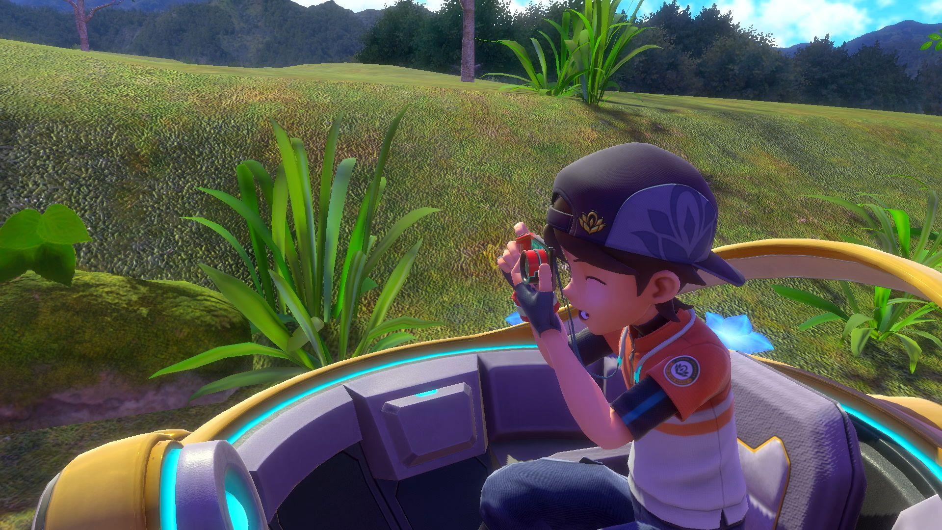 """Ein Junge macht ein Foto mit einer Kamera im Spiel """"New Pokémon Snap""""."""