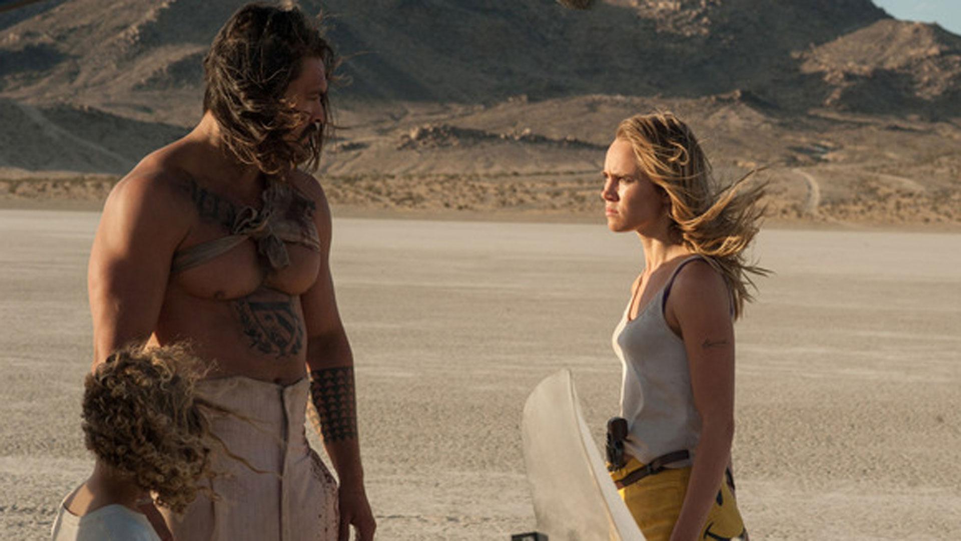 In der Wüste stehen sich drei Personen gegenüber
