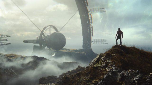 Ein Mann steht auf einem Berg vor einer großen Maschine im Spiel Deathloop