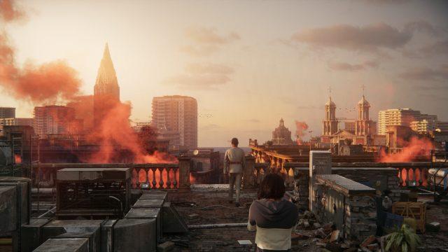 """Antón Castillo (Giancarlo Esposito) und sein Sohn Diego auf einem Dach über brennenden Häusern im Spiel """"Far Cry 6""""."""