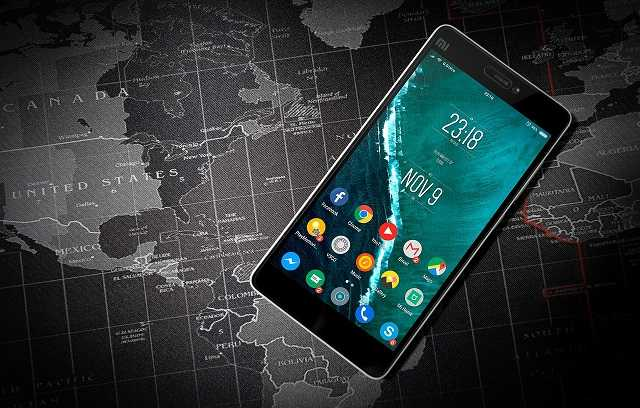 Android smartphone lying on a world map