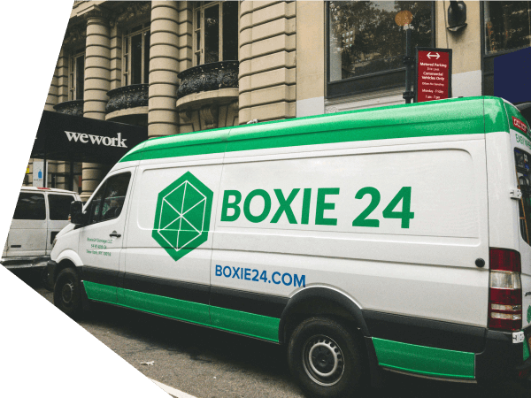 A van with the Boxie24 logo on it.