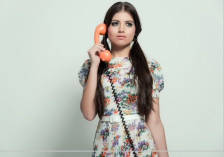 Retro 70s fashion. Pretty brunette girl with long hair. Calling.