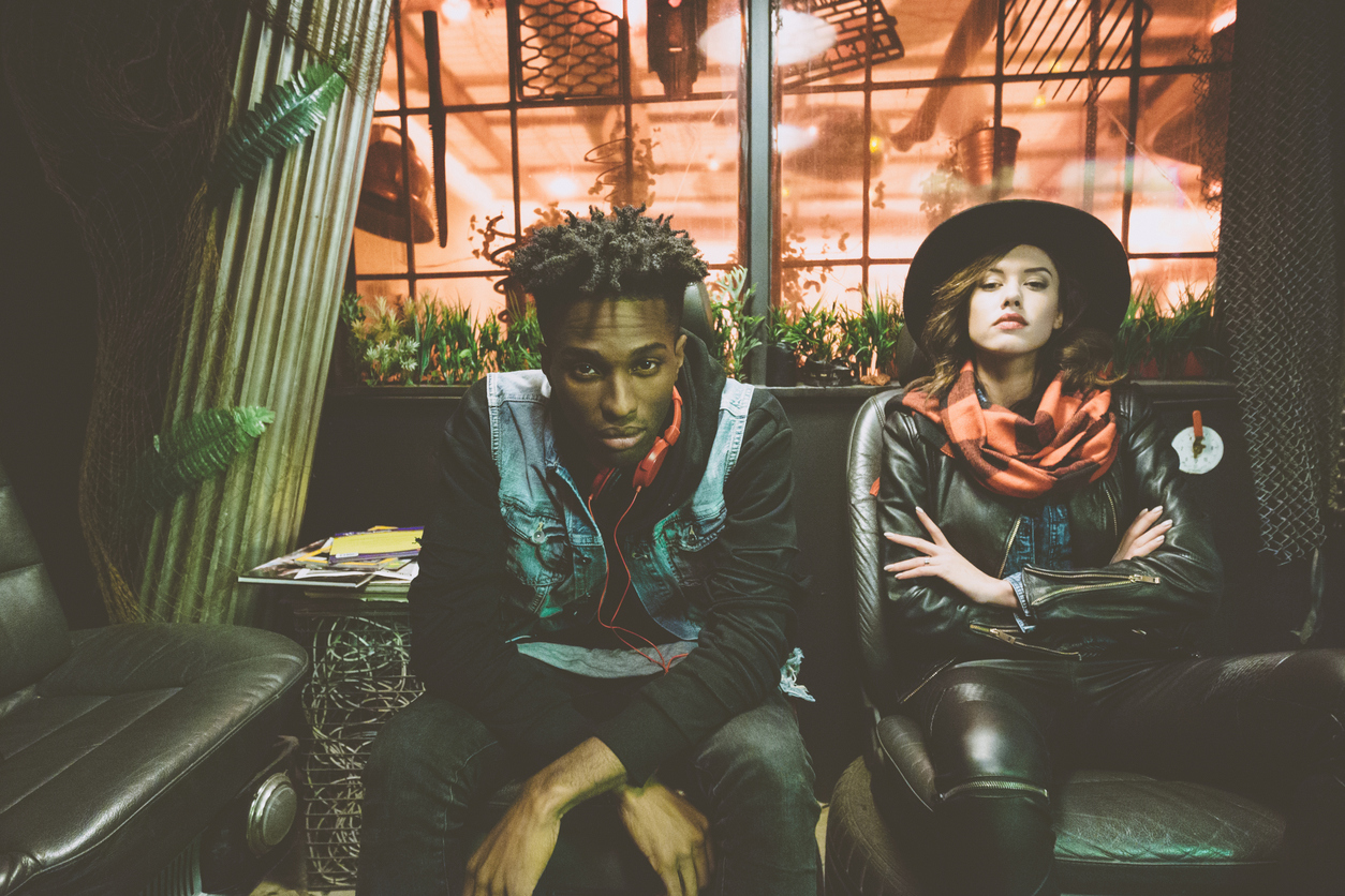 Fashion portrait of afro american guy and beautiful woman