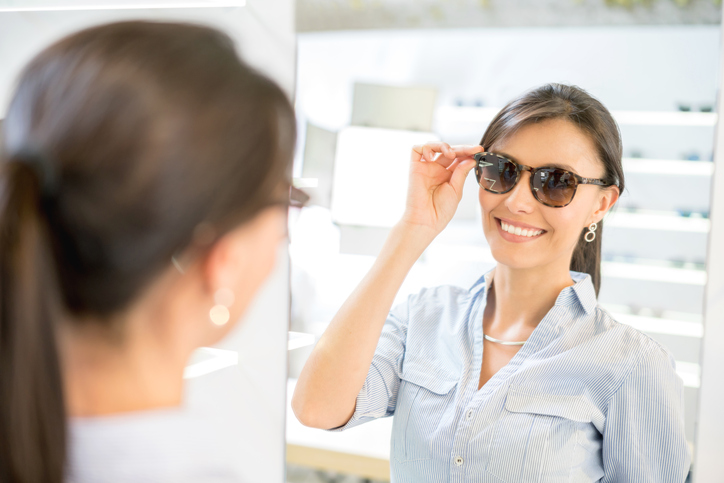 Woman buying sunglasses at the optician's shop