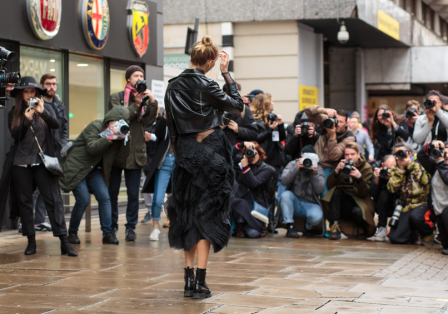 Elena Perminova surrounded by photographers during London Fashion Week