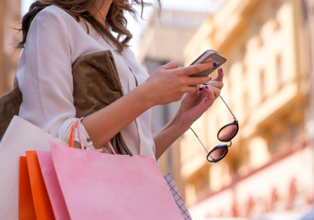 woman checking daily deals on smartphone