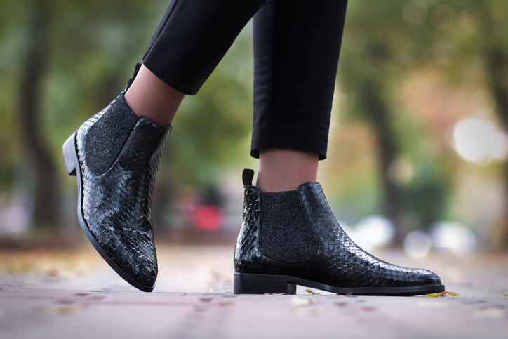 A girl steps in python leather shoes