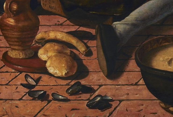 Detail met worst, broodjes en mosselschelpen.