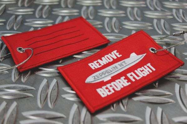 "Kofferanhänger ""Remove Before Flight"""